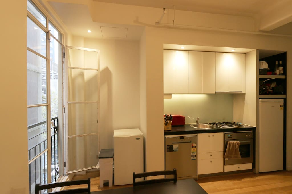 Open plan kitchen and dining with Juliet balcony.