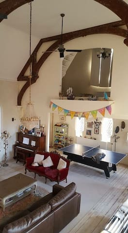 Downstairs living space with table tennis and pool table.
