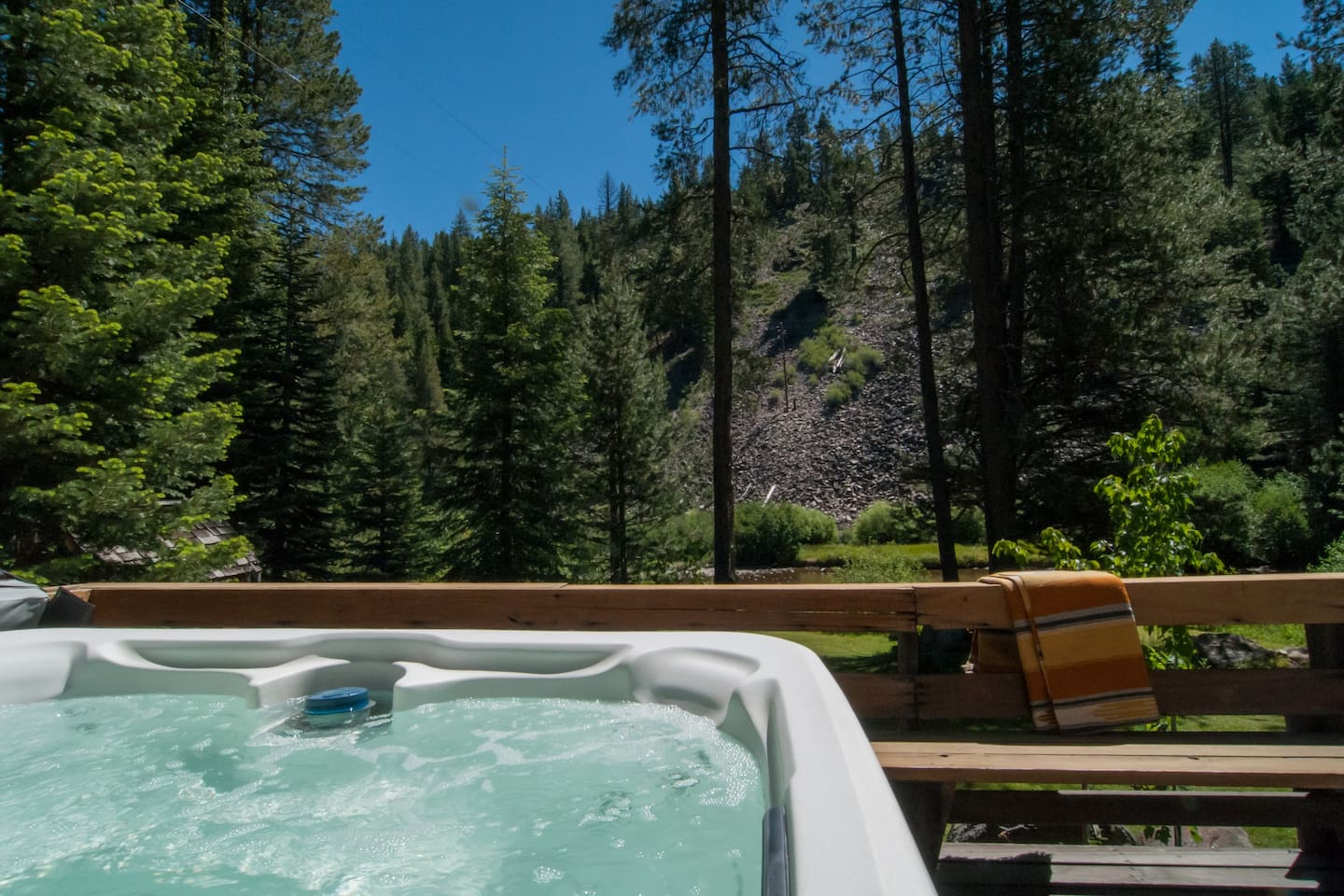Hot tub over looking river.