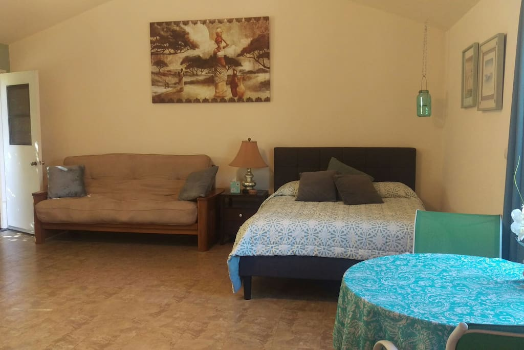 spacious room with super comfy queen bed and a futon that folds to a full for extra guest
