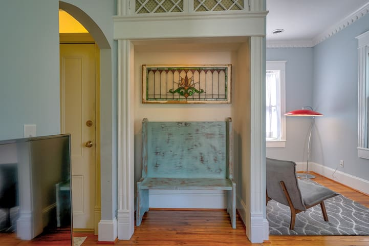 Entry bench with stained glass panel sourced from family property in Richmond , VA