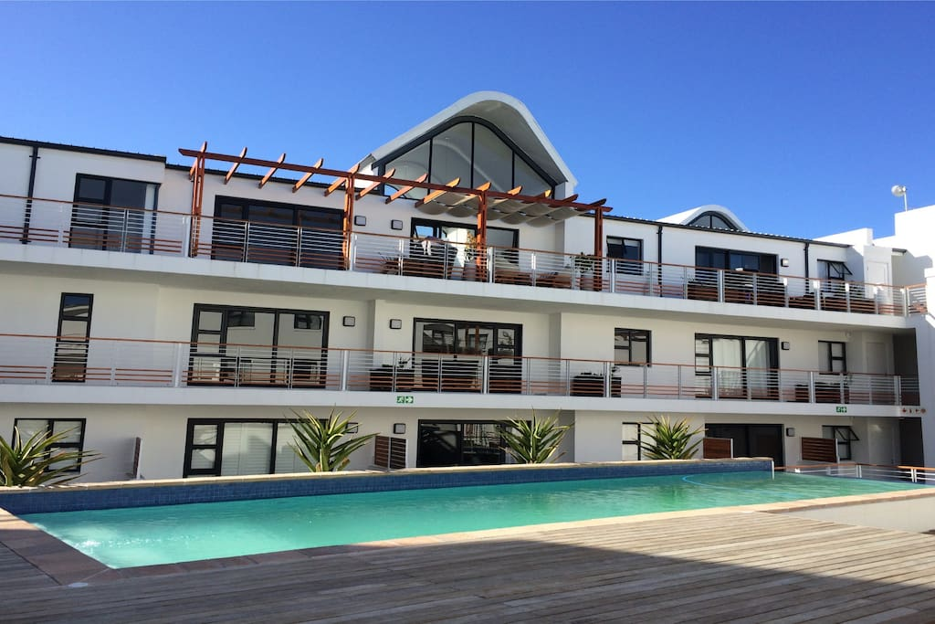 Balcony of apartment overlooks the pool.