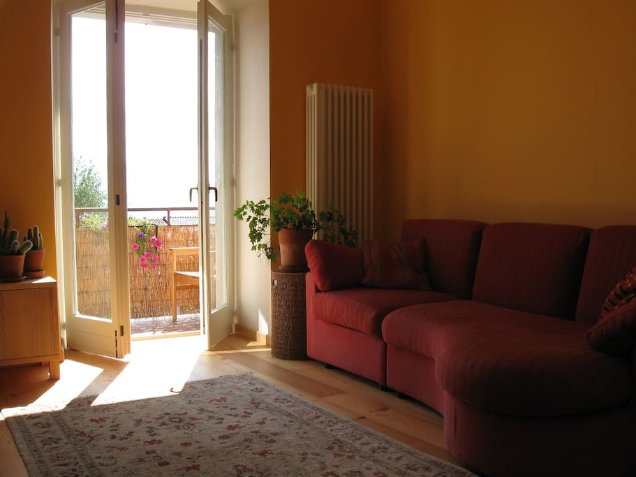 The sitting room has a wood burning stove and gives onto the balcony. The sofa also makes a very comfortable single bed.