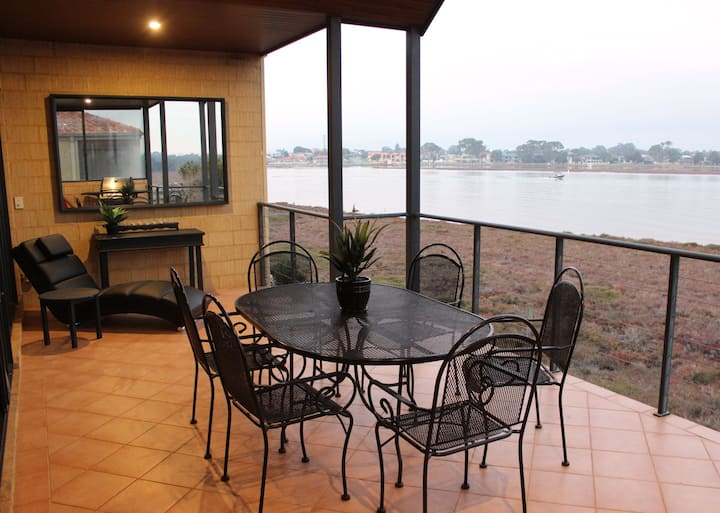 Spacious private town house with water views.