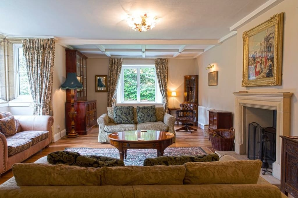 The drawing room with comfy sofas & a wood burner