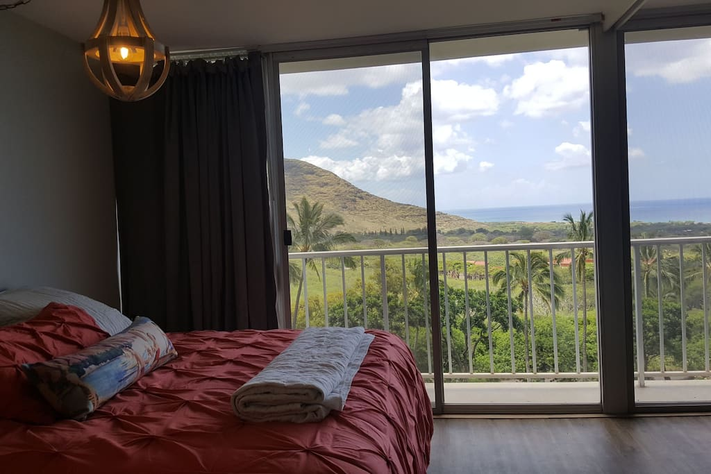 "bedroom and lanai with black out drapes and 40"" flat screen TV"