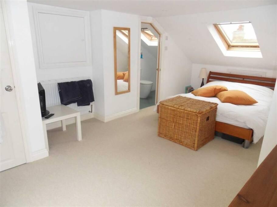 En-suite double bedroom at top of house.