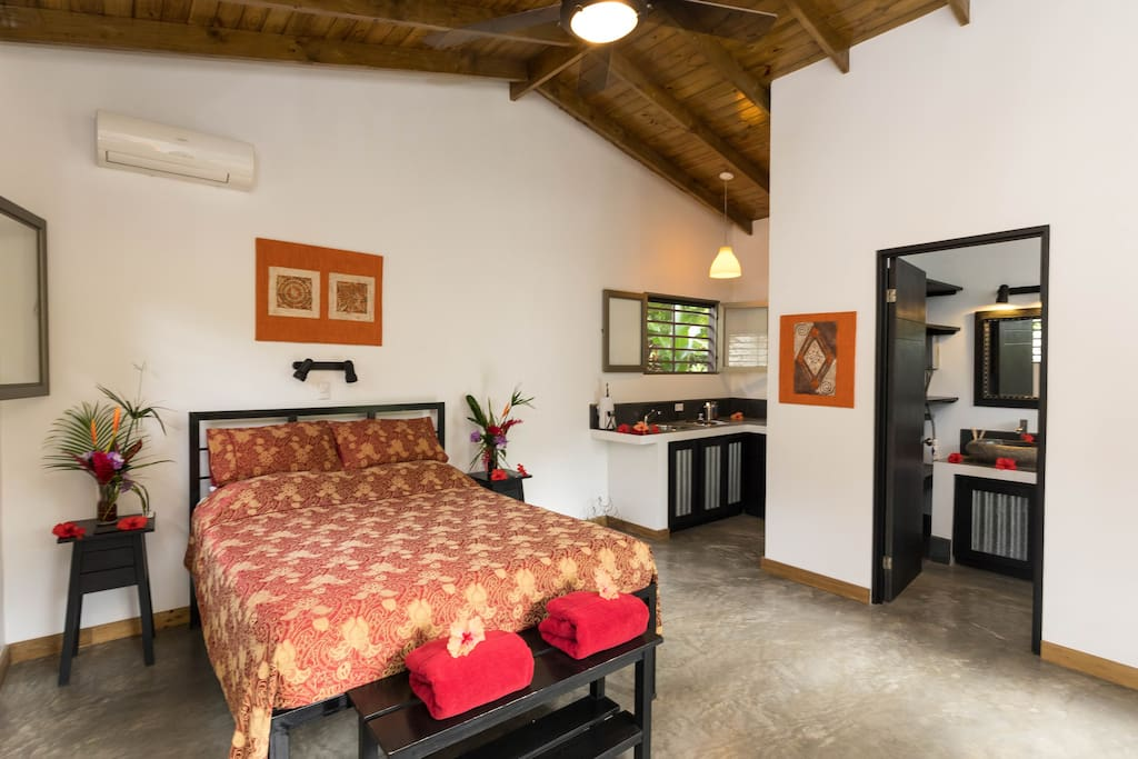 Inside of your casita with a comfortable Queen sized bed