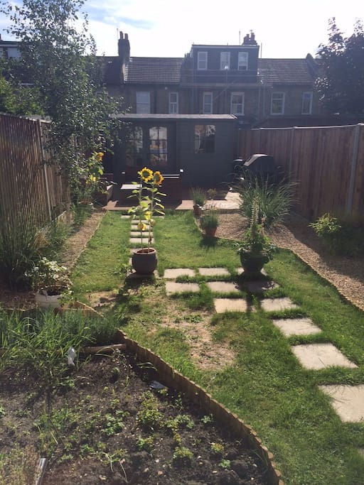 The large south-facing garden is a comfortable place to relax and unwind.