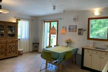 Domaine la Pique, Tournesol, dining area, double doors opening to the private terrace