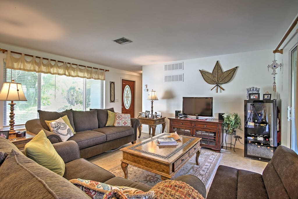 When you're not lounging on the beach, kick back and relax amidst this home's open-concept layout and comfortable furnishings.