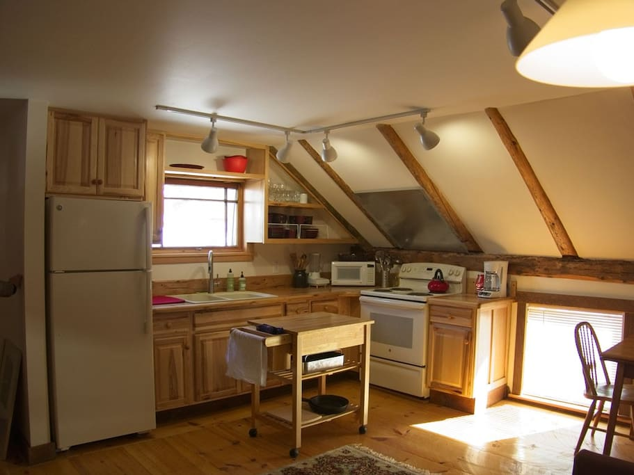 Kitchen / Dining Nook: full size appliances, exposed beams - plus a lovely view down Main Street!