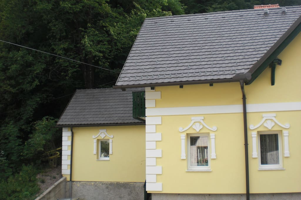 The Pink House (left) is actually yellow, its a former outhouse quirkily renovated!