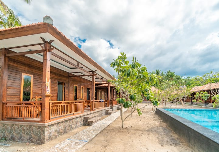 Your Lovely Beachfront Cabin in Wonderful Island