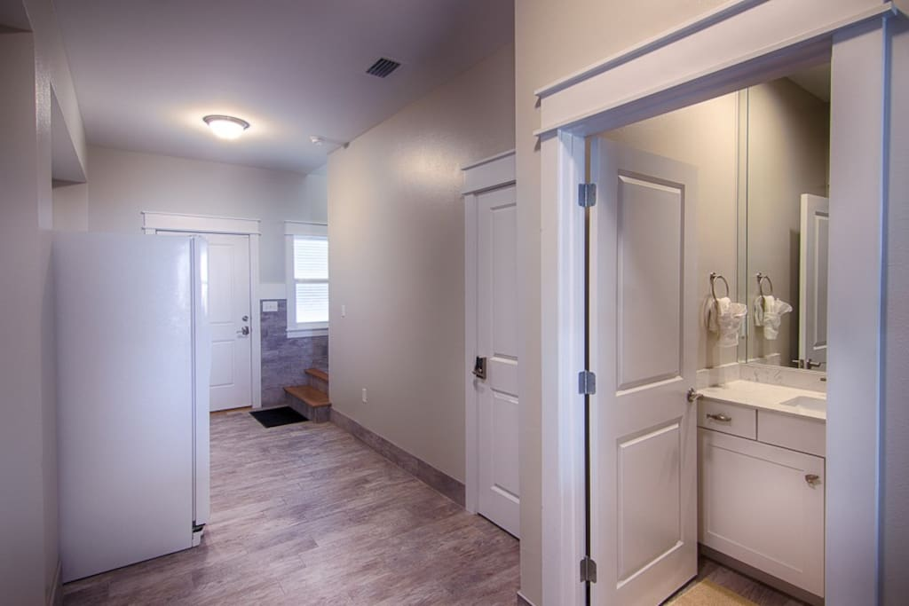 Clean ground level entrance with refrigerator and half bath.