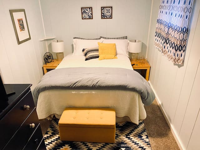 """The second bedroom has a queen bed and a 24"""" TV with Amazon Firestick and live TV on YouTube TV. We can set up a Pack-and-Play, toddler cot, or twin air mattress in this room if you would need to accommodate additional kids in Mom & Dad's space."""