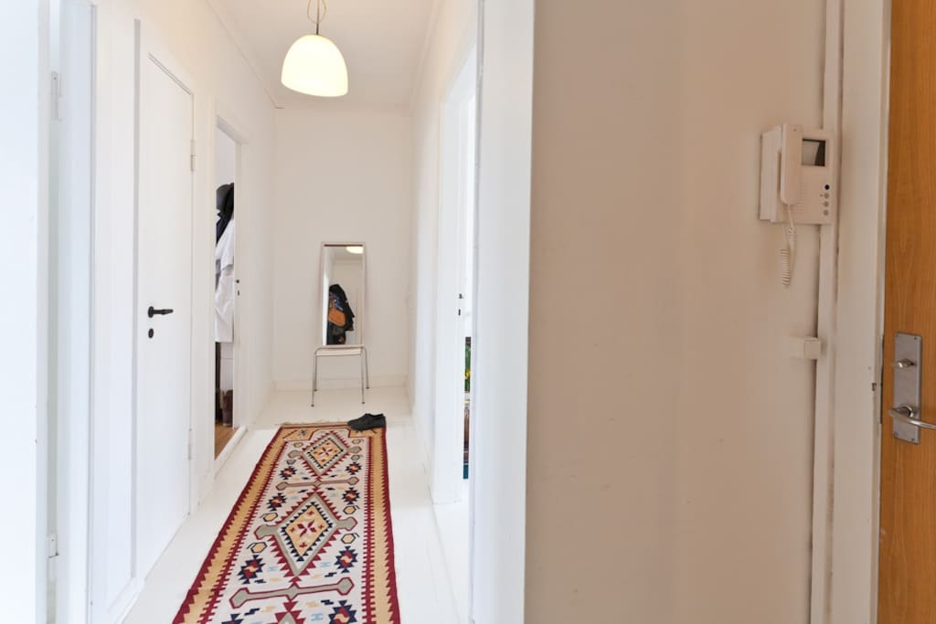 entrance - bedroom to the left, quiet, facing courtyard with small balcony, living rooms, kitchen on the right.