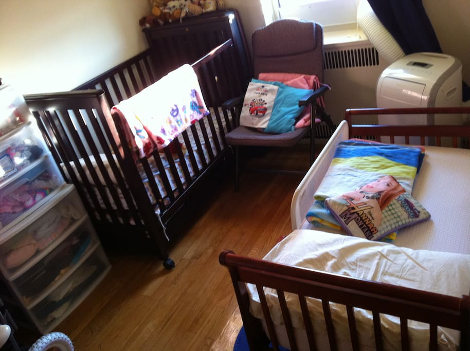 Kids bedroom with two toddler beds (NO crib - we just got another toddler bed). Plenty of storage space