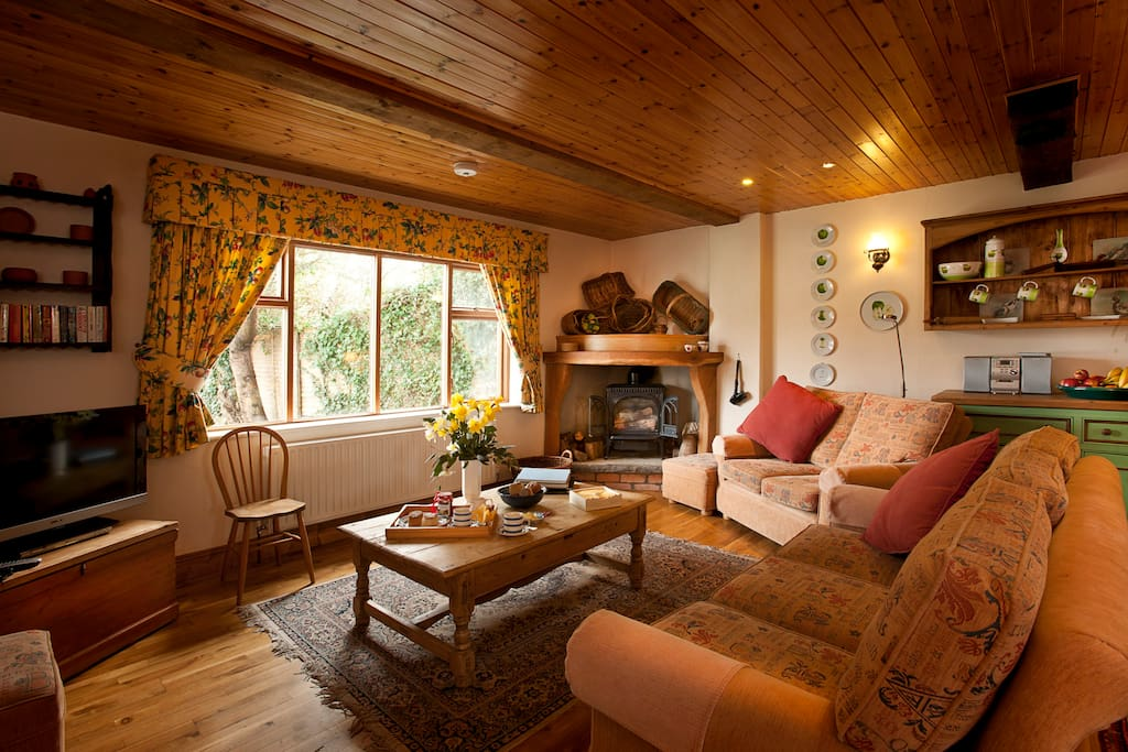 Apple Loft Cottage is a spacious 2 bedroom, two-storey cottage with an open-plan lounge and traditional features such as oak beams, solid oak flooring, and a feature fireplace.