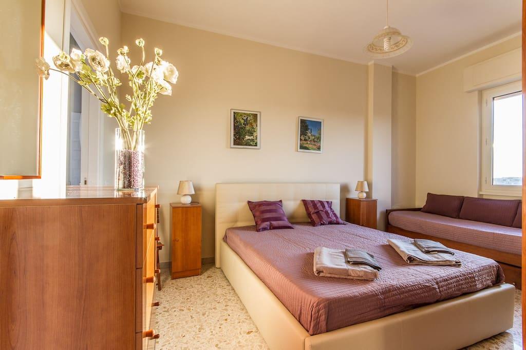 Camera letto 3/4 posti letto con bagno privato