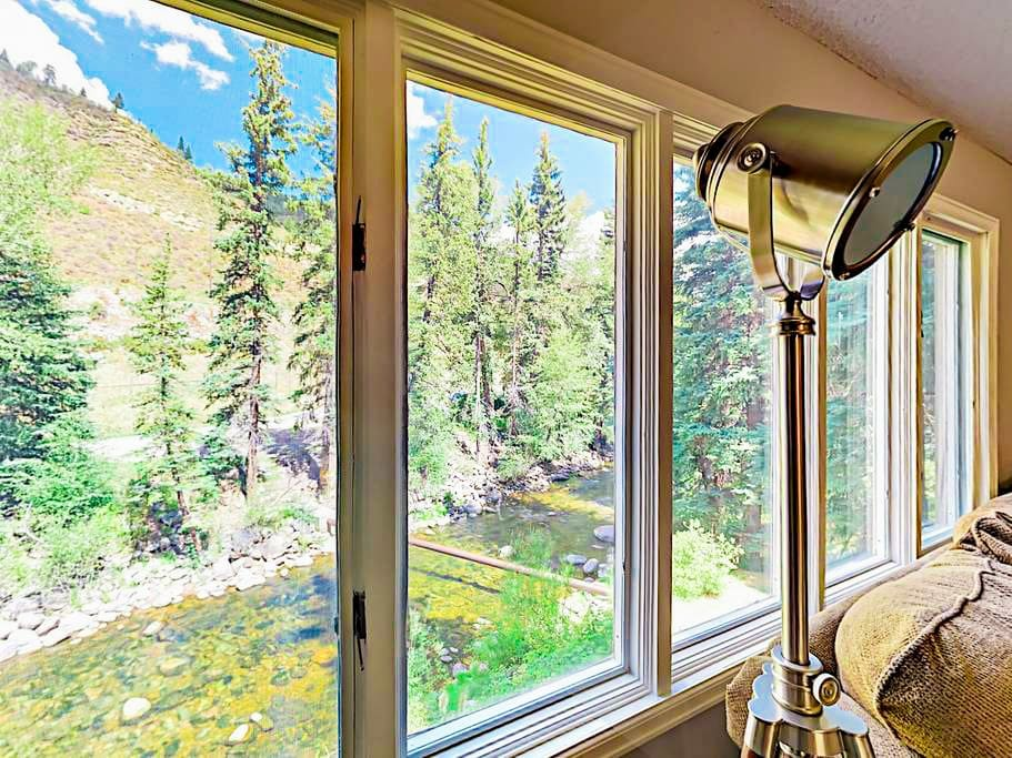 Your rental is located on trout-rich Gore Creek with alpine views.