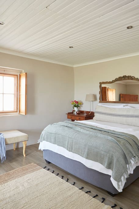 Cottage 3 - Main bedroom with queen size bed and ensuite bathroom.