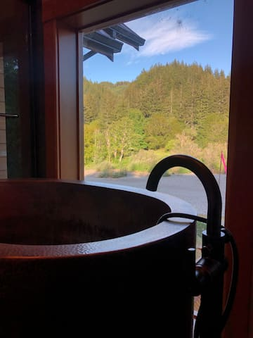 Copper soaking tub with stellar views of the river!