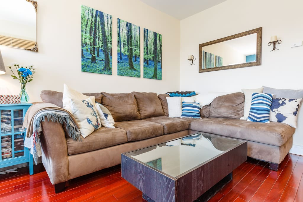Comfy couch in living room under blue bell woods
