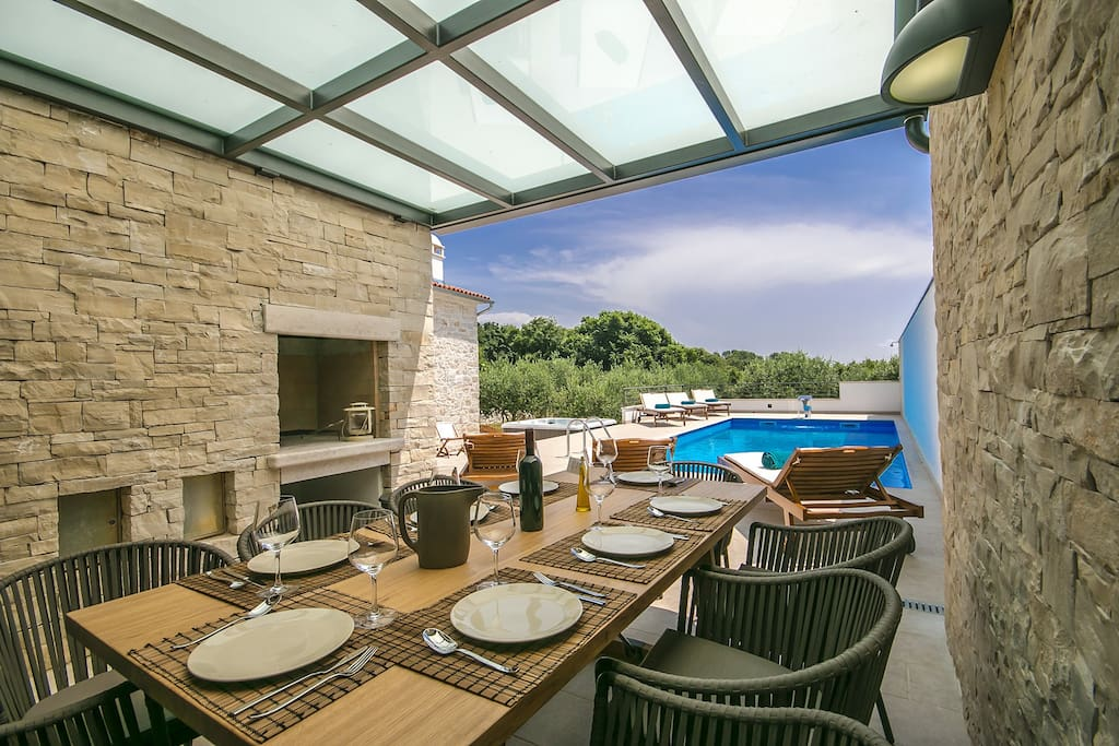 Covered terrace by the pool