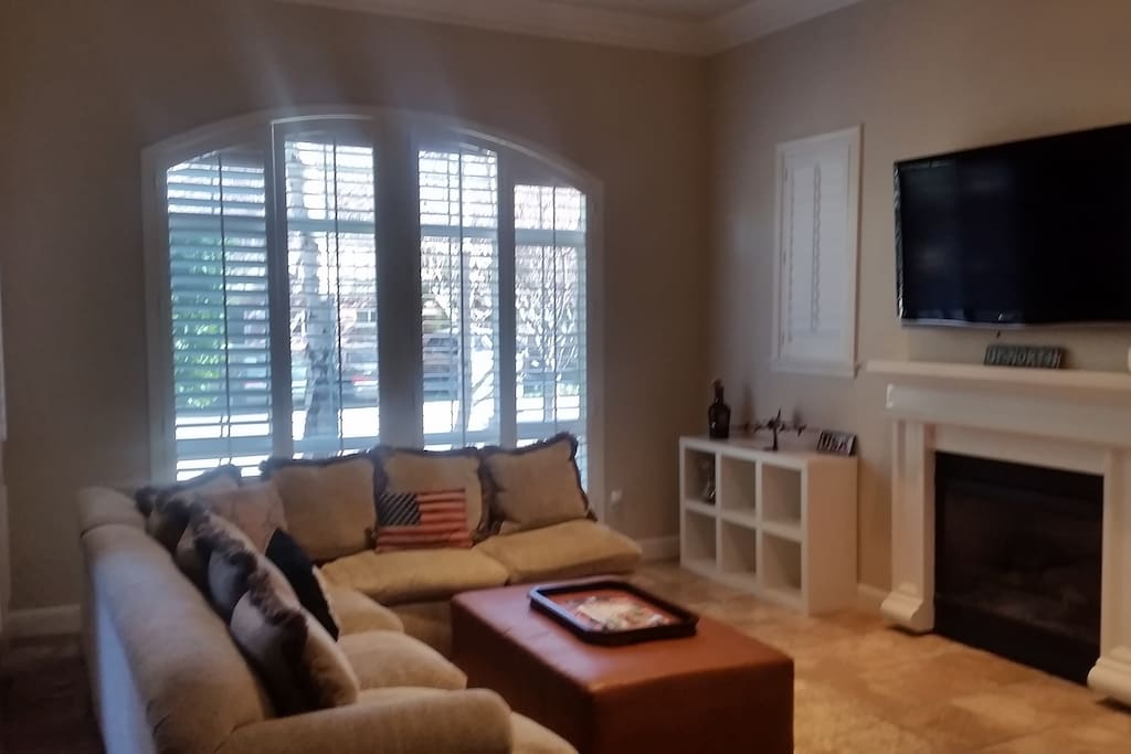 Spacious and open living room with gas fireplace