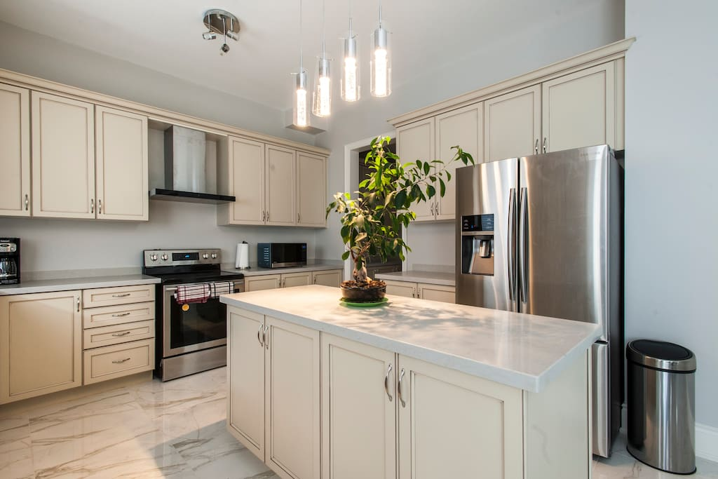 Brand new Kitchen with SS appliances and custom vanities, stained maple hardwoods kitchen cabinet.  Brand new coffee maker, kettle, cooking hardware. Enjoy coffee or tea in our complementary kitchen.
