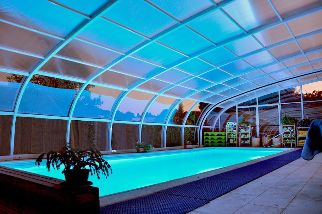 pool at night time - roof close