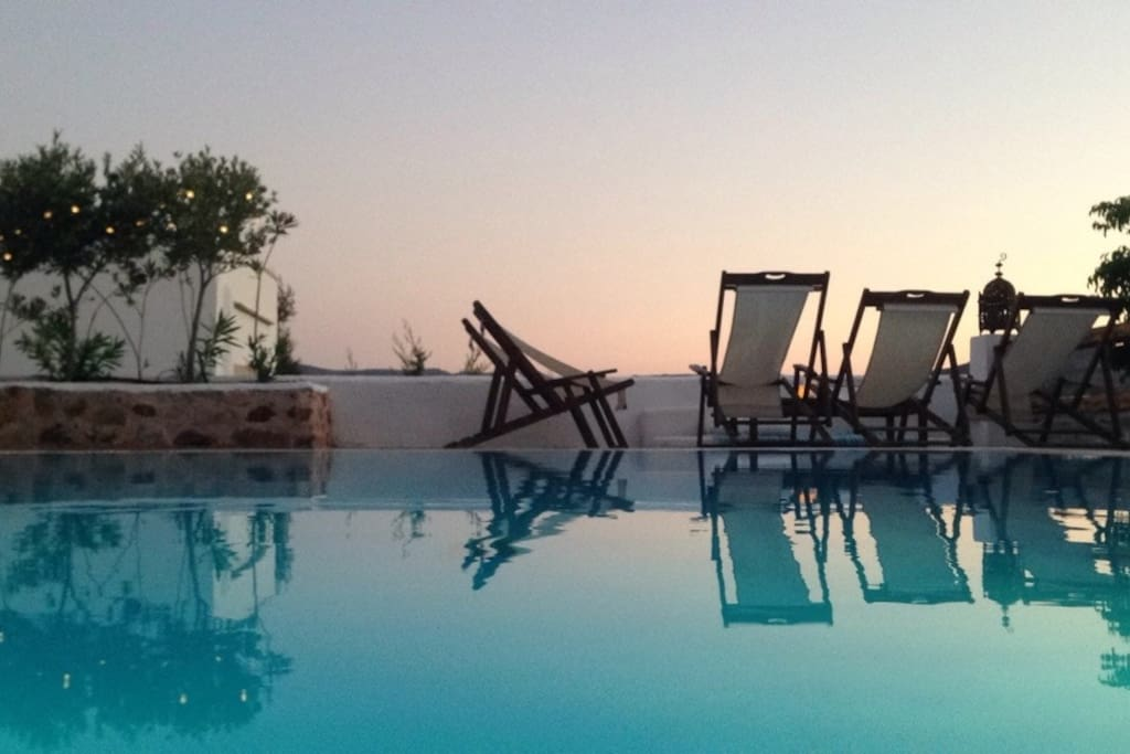 Pool level at dusk. Some  visitors enjoy private Yoga lessons here at this time. Can be arranged.