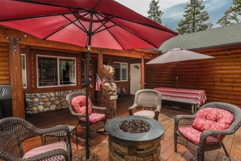 Huge front deck with fire pit, BBQ grill, and lots of seating for family and friends.