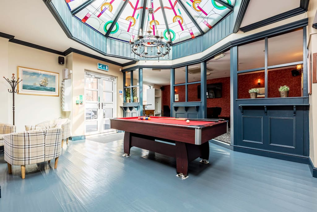 Lobby and pool table - games room. Table football, Air Hockey and Retro arcade games. Spotify / Sky T.V on large screen T.V / google / Siri and Alexa
