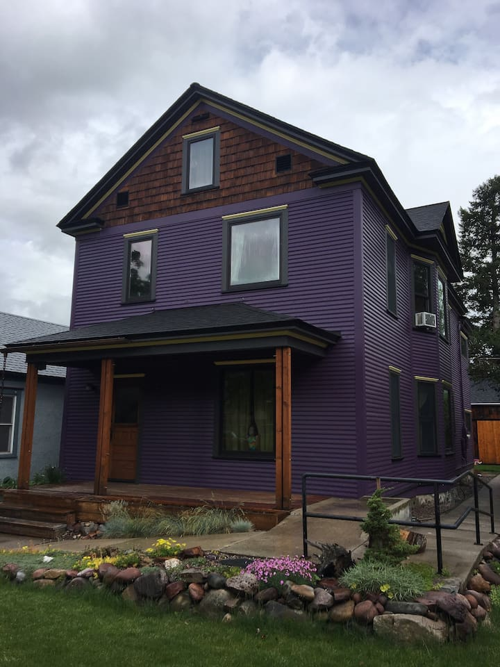 This is the front of the house, the front door allows access to all apartments. The top floor is the Airbnb.