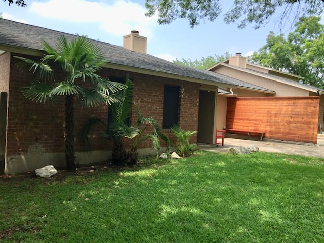 Front entrance to Guest House, private driveway parking with cedar privacy fence.