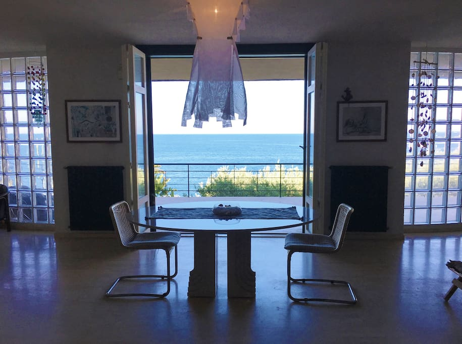 The view from the villa , dining table designer  Carlo Scarpa  by  SIMON International model Samo  With chairs Marcel Breuer