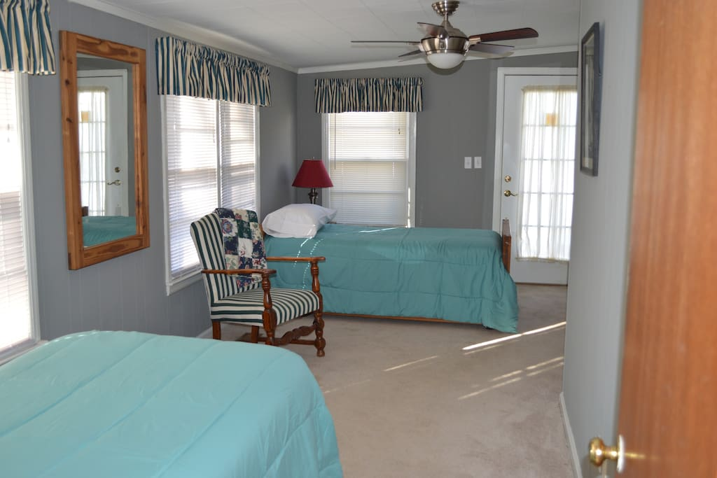 1st. Bedroom with 2 twins and trundle bed , sleeps 3 total and back door entrance to yard