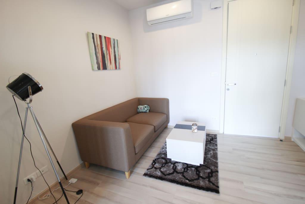 Leather sofa with Studio Lamp