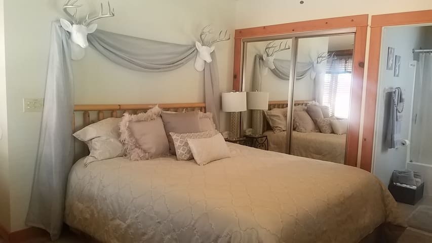 As many reviews have stated that the cabin is incredibly comfortable.  The master bed is absolutely one of THE most comfortable beds you'll ever sleep on!! This room has a private full bathroom with all the necessary amenities for a very comfortable stay. It also has a private entrance and exit.