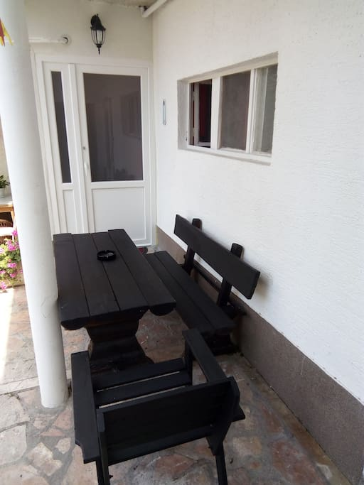 entrance with big wooden table to enjoy sun