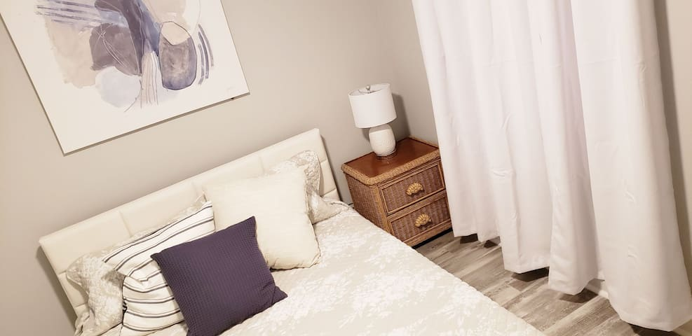 guest bedroom w comfy queen size bed • ample closet space • window for natural sun light