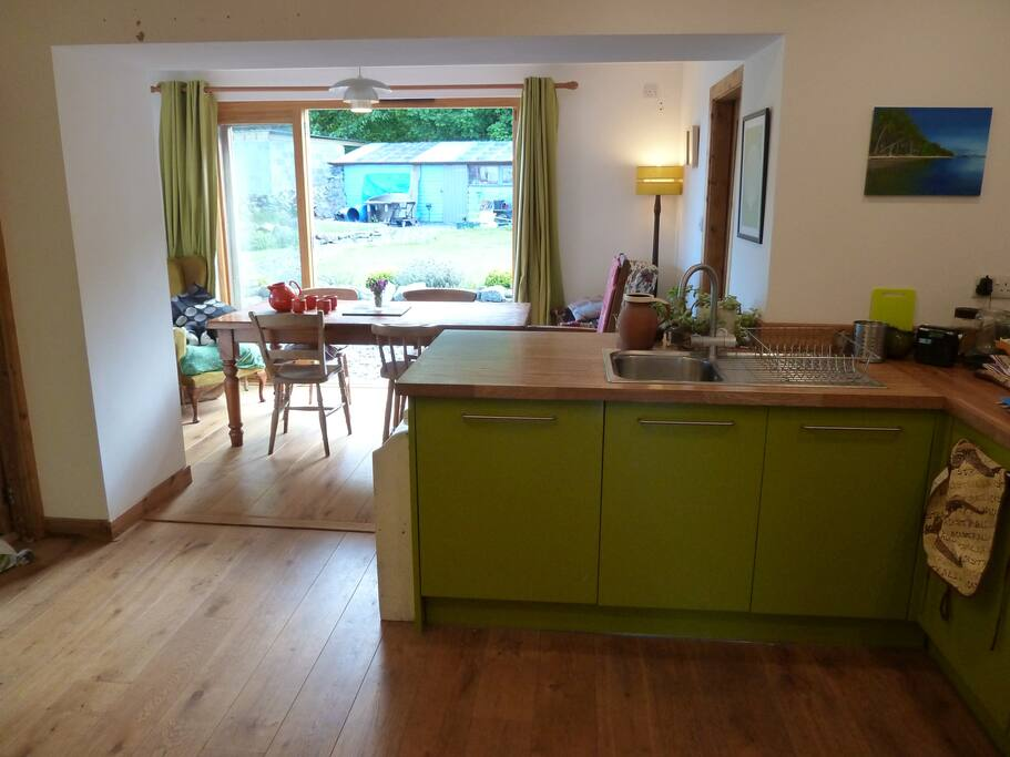 Kitchen diner with double doors to garden. Table seats 6 very comfortably and 8 at a push.