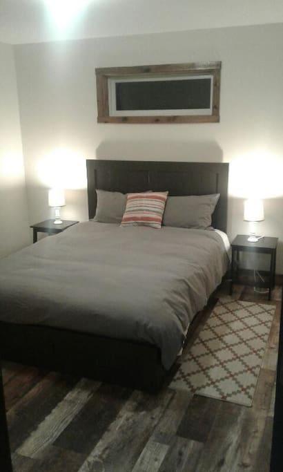 Bedroom with queen bed.