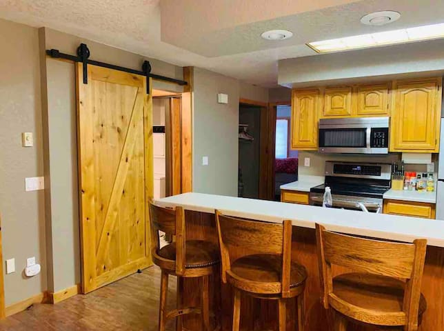 Recently updated condo with new kitchen appliances, new floors and barn door.