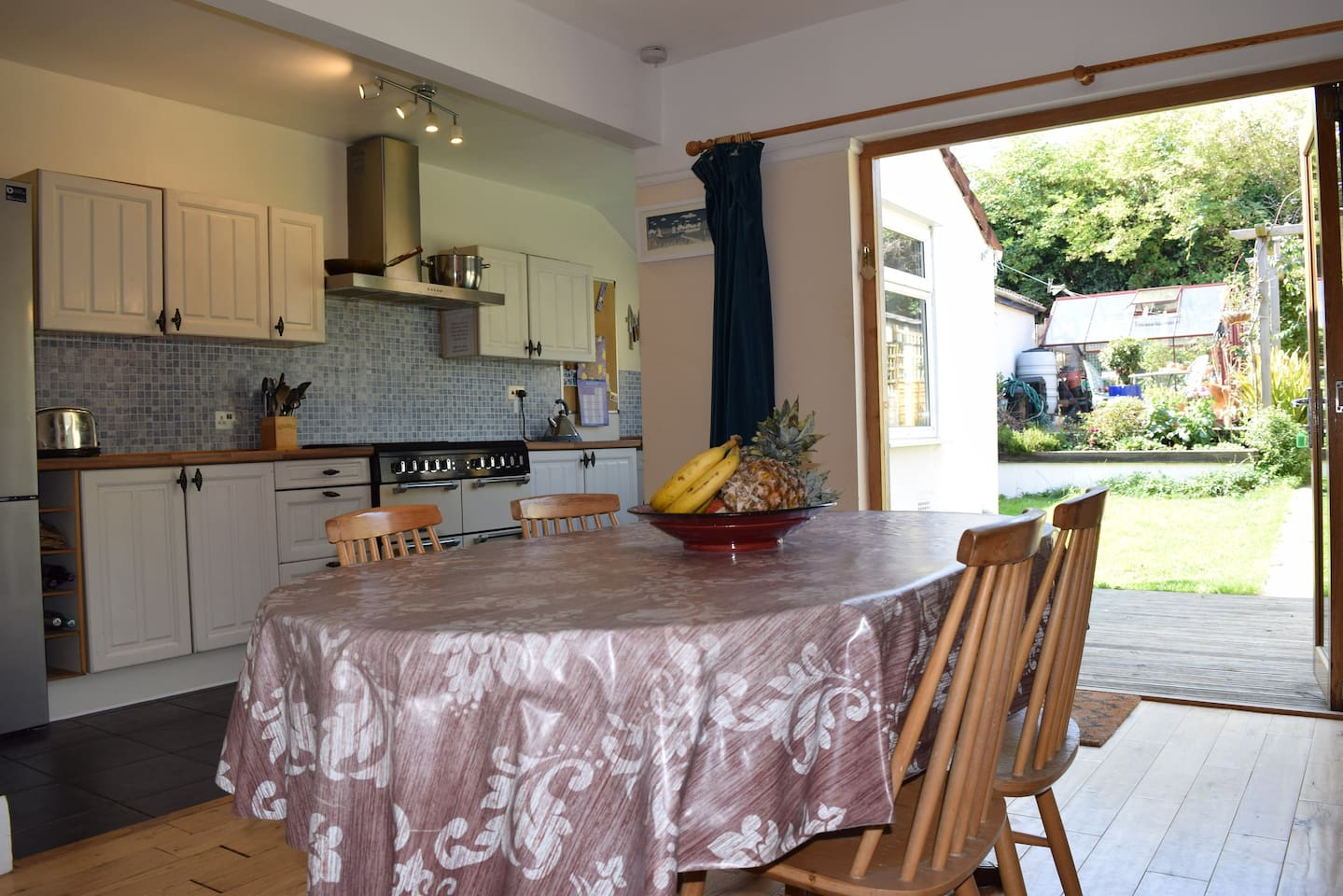 Open living space offering dining room and kitchen with lovely folding doors out into the garden.