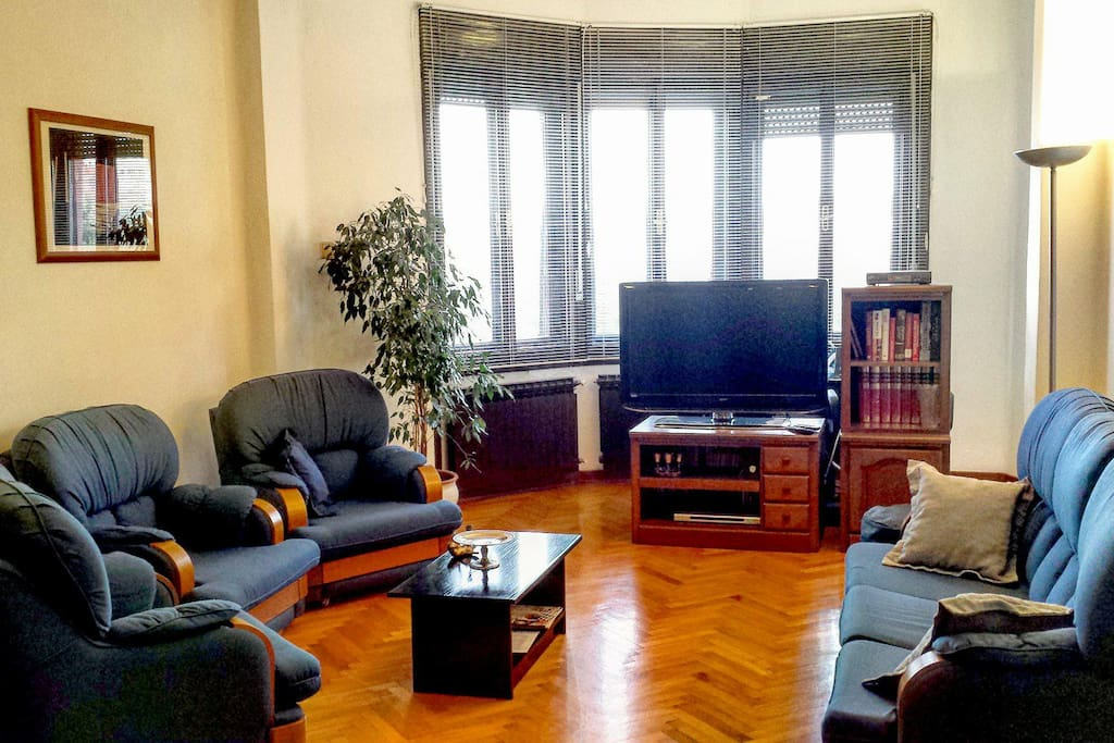 The living room is ample and features views over the central square