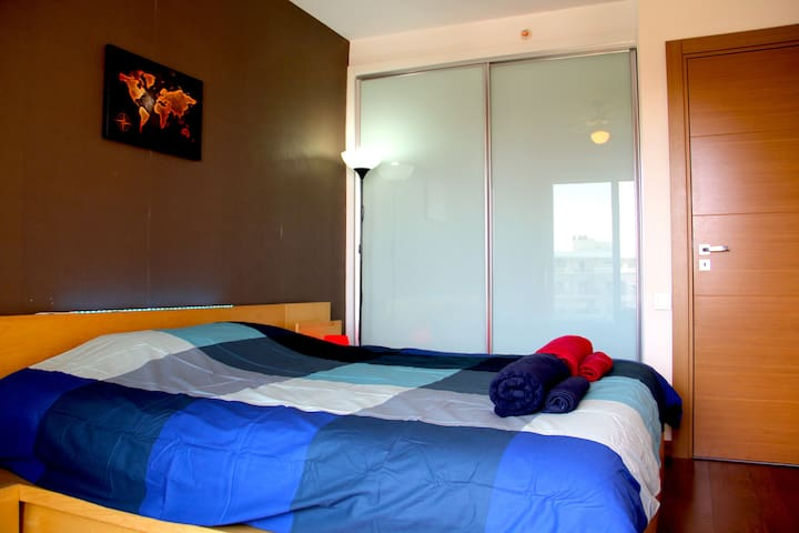 very comfy king-size bed in large bedroom for a good sleep
