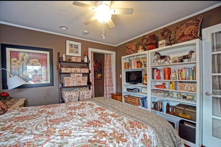 Warm comfortable bedroom Queen size bed